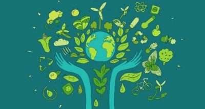 green hands with earth